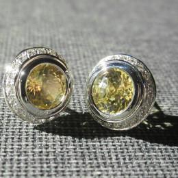 Yellow sapphires and diamonds earrings.