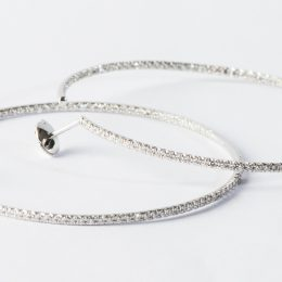 White gold and diamonds hoops.