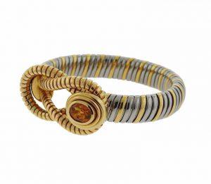 Bracelet tubogas or jaune, acier et citrine Cartier.