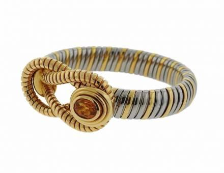 Yellow gold, steel and citrine spirotube bracelet, Cartier (Sold)