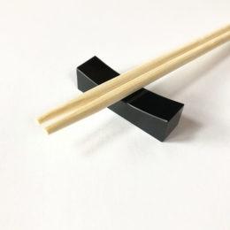 Black jadeite chopsticks rest.